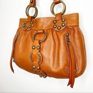 Danier Leather tan leather studded boho hobo bag